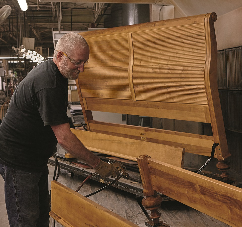 Andy Mahan Who Has Worked At Ethan Allen S Plant In Old Fort For 13 Years Sprays Toner On A Piece Of Furniture Photo Courtesy